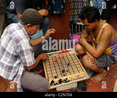 thai chinese men playing chinese checkers (draughts), Yaowarat Road , chinatown, bangkok, thailand - Stock Photo