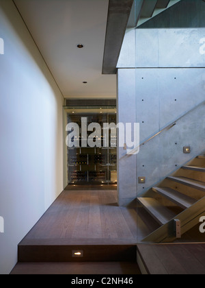 Modern detached house, West Hollywood, California. Interior stairs and wooden flooring - Stock Photo