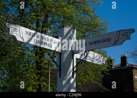 Signpost showing the way to North Dulwich Station, Camberwell and West Norwood, Dulwich Village, London, SE21, England - Stock Photo