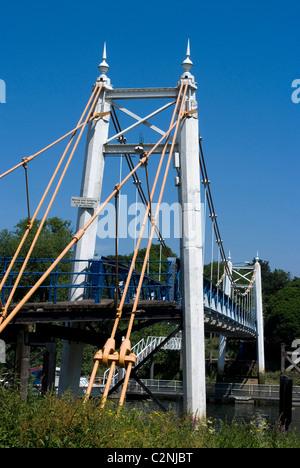Suspension bridge over the River Thames at Teddington, near Richmond, Surrey, England - Stock Photo