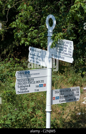 Signpost describing points on the Thames path and Thames Cycle Route, Teddington Lock, Teddington, Surrey, England - Stock Photo