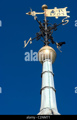 Weather vane on top of the steeple of St Mary Church clock tower, Sussex, Englan - Stock Photo