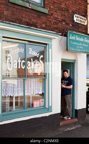 UK, England, Staffordshire, Leek, Haywood Street, man queueing outside oatcake shop - Stock Photo
