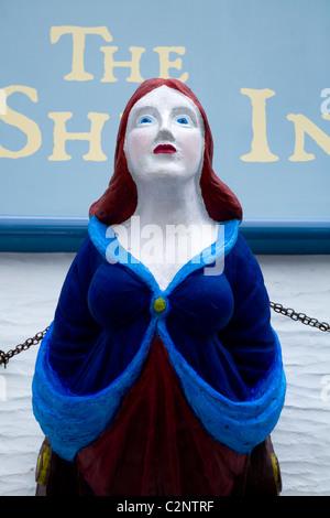 Ship figurehead display sign on the pub / tavern 'The Ship Inn', on The Coombe, in Polperro. Cornwall. UK. - Stock Photo
