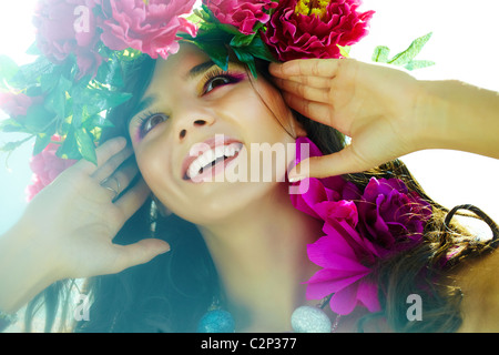 Beautiful woman with bright flowers in good mood - Stock Photo
