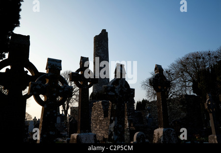 The Round Tower and High Crosses at the Monastic Site at Monasterboice, County Louth, Ireland - Stock Photo