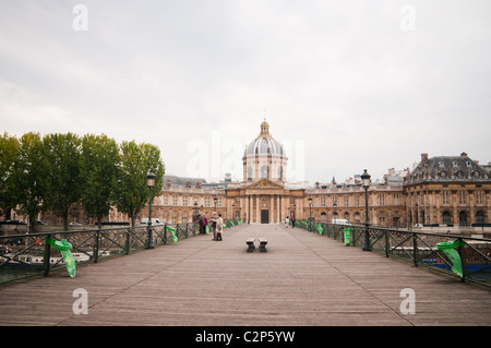 'Le pont des Arts' with the French Institute in the background - Paris, France - Stock Photo