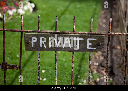 Private sign on old rusty garden gate