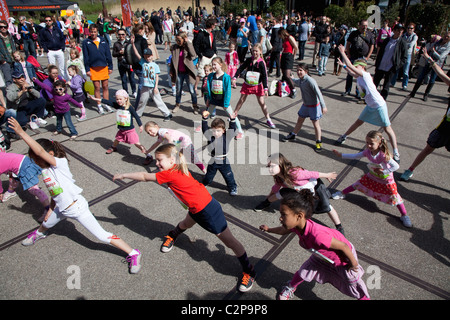Warming up for children in the Westerpark, Amsterdam, The Netherlands - Stock Photo