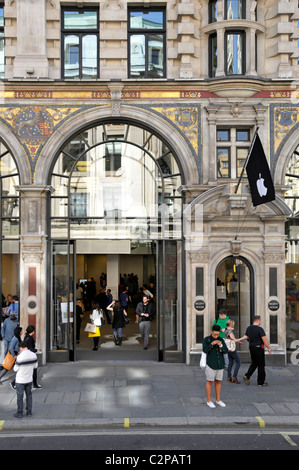 People outside the Apple store in Regent Street London - Stock Photo