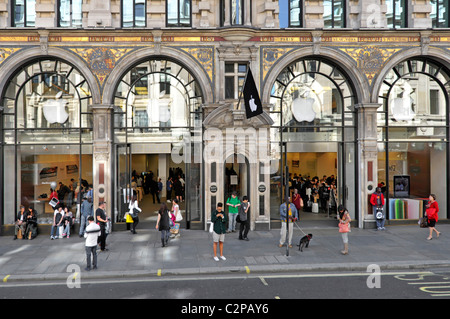 People on pavement outside the Apple American technology business flagship retail store in Regent Street London - Stock Photo