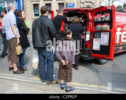 People and Tourists buying coffee from a van at the Ramsbottom Chocolate Festival, April, 2011, Lancashire UK - Stock Photo