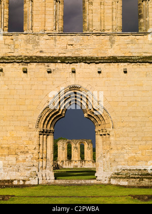 Byland Abbey. View through the west entrance along the nave. - Stock Photo