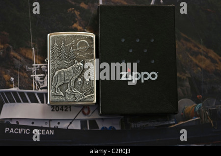 zippo lighter, timber wolf, boat background - Stock Photo