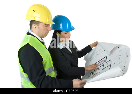 Two young architects looking on house plans - Stock Photo