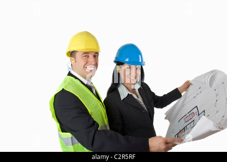 Architect showing at a client the plan for house,both looking at camera smiling - Stock Photo