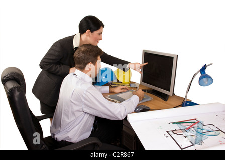 Young team of architects in office working,architect woman pointing on computer screen - Stock Photo