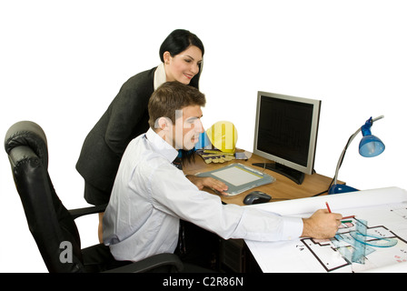 Architect man showing his colleague woman a plan for house and she smiling - Stock Photo