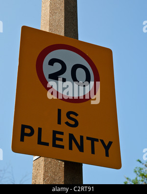 20 is plenty road speed limit sign attached to a lamp post in Littlehampton, West Sussex - Stock Photo