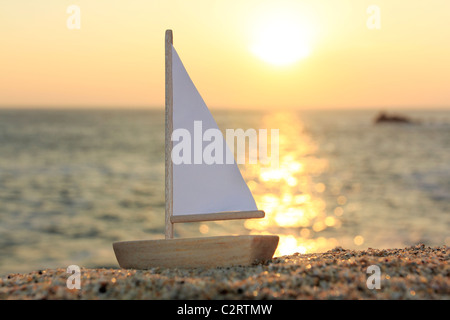Model boat on beach - Stock Photo
