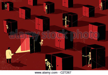Man with flashlight looking for skeletons in closets - Stock Photo