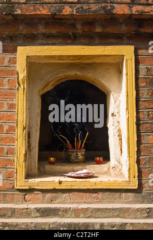 Vertical view of one of the ten shrines in the courtyard at Tran Quoc Pagoda the oldest Buddhist temple in Hanoi. - Stock Photo