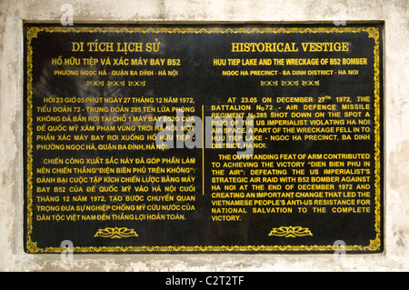 Horizontal close up of a plaque regarding the 'Christmas Bombings' of 1972 close to the wreckage of a B-52 bomber - Stock Photo