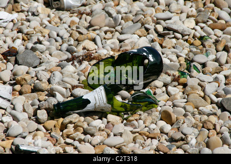 broken bottle on floor ground in sun - Stock Photo