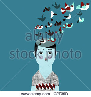 Man with flock of birds coming from head - Stock Photo