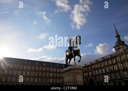 Equestrian statue of King Phillipe III in front of the Casa de la Panaderia, Bakery House,  in the Plaza Major, - Stock Photo