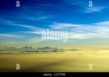 Sunrise clouds shined from above with the sun. View from airplane. - Stock Photo