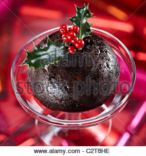 Christmas pudding whole holly berries - Stock Photo