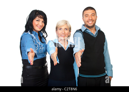 Three business people standing with their hands straight for handshake and smiling isolated on white background - Stock Photo