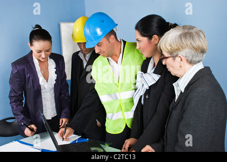 Architect team in office having a discussion at meeting and smiling together,an engineer man showing or design something - Stock Photo