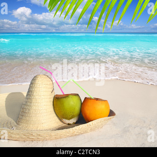 Coconuts in Caribbean beach on mexico sombrero hat tropical turquoise - Stock Photo