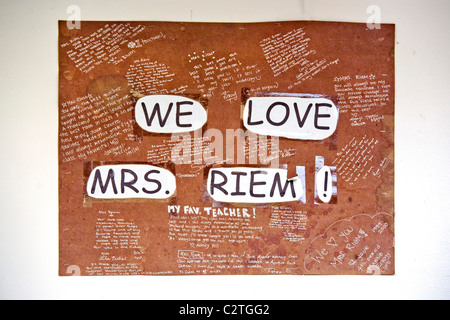 A hand-lettered sign in a high school chemistry classroom expresses students' appreciation of their teacher in San - Stock Photo