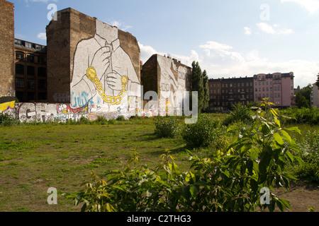 Giant streetart mural by artist Blu in Kreuzberg Berlin - Stock Photo