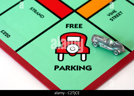 A car on the 'Free Parking' space on a monopoly game board UK - Stock Photo