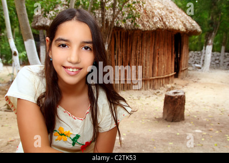 Mexican indian Mayan latin girl in jungle cabin house Mexico - Stock Photo