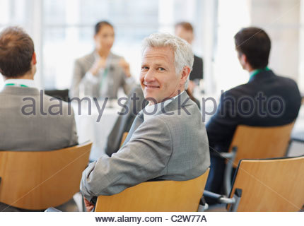 Business people attending seminar in office - Stock Photo