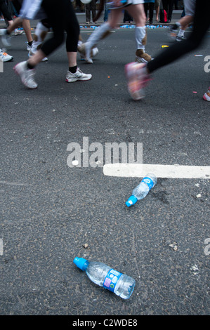 London marathon 2011 - discarded water bottles and runners feet (with motion blur) - Stock Photo