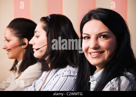 Happy three customer service women working in office and giving information - Stock Photo