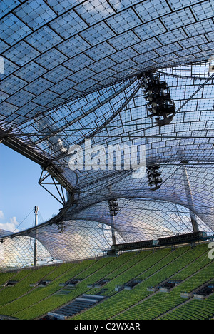 Germany Bavaria Munich 1972 Olympic Stadium curved section of bright green seating under canopy roof of acrylic - Stock Photo