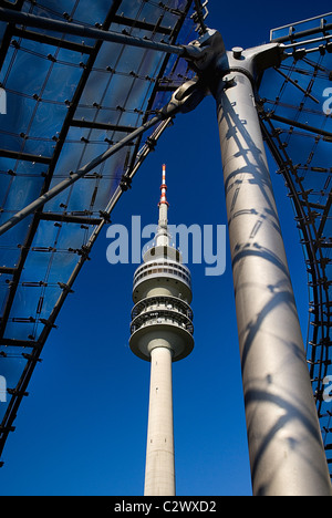 Germany Bavaria Munich 1972 Olympic Stadium section of acrylic glass canopy roof and Olympic Tower. - Stock Photo