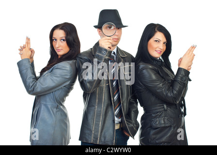 Detective man with hat and magnifying glass standing in the middle of two beautiful detectives women - Stock Photo