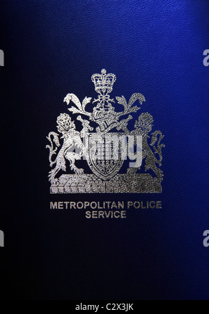 Silver London Metropolitan Police Service symbol printed onto blue Background. - Stock Photo