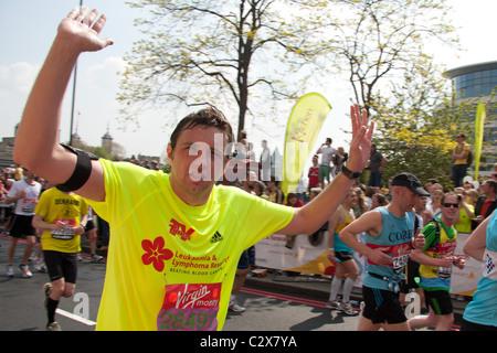Charity runners in the 2011 Virgin London Marathon - Stock Photo