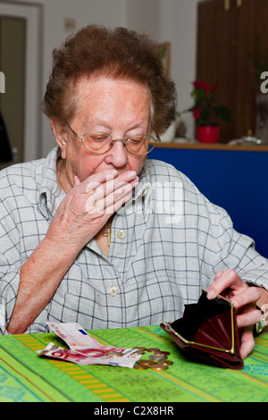 Old woman counting money - Stock Photo