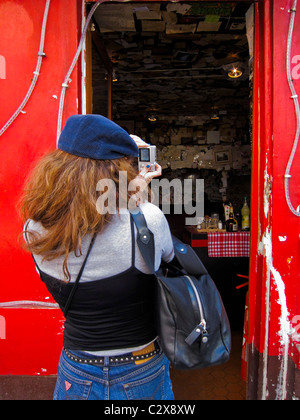 Paris, France, People Visiting Montmartre District, Woman Tourist Taking Photos of old Restaurant - Stock Photo