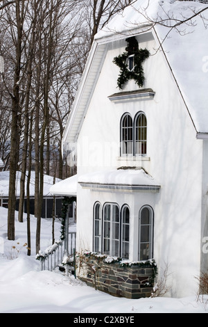 Waterloo Quebec Canada A House Covered In Snow In The